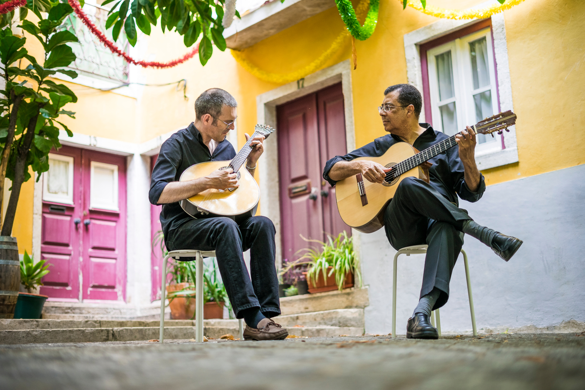 Two men playing acoustic guitar Fado music World Portugal Day