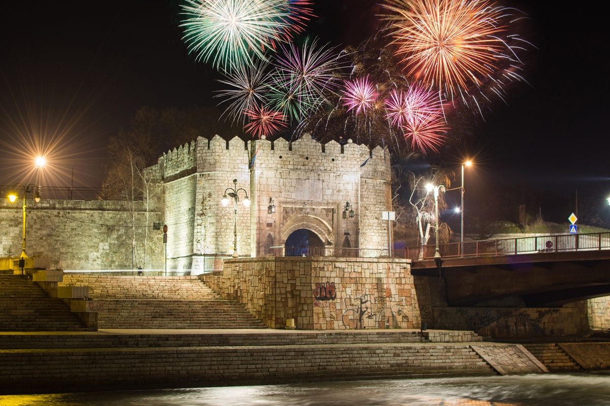 View of Nis FOrtress with fireworks in the night sky travelling to Serbia