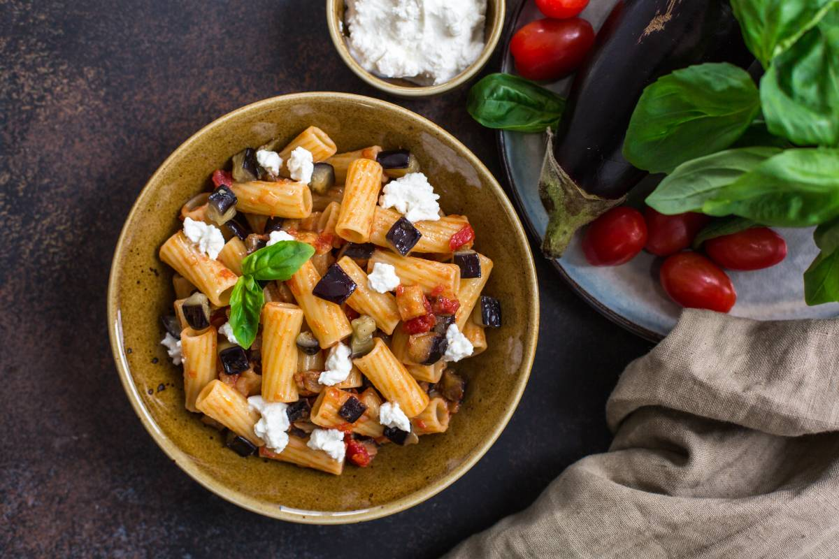 A bowl filled with Pasta alla Norma, World Pasta Day