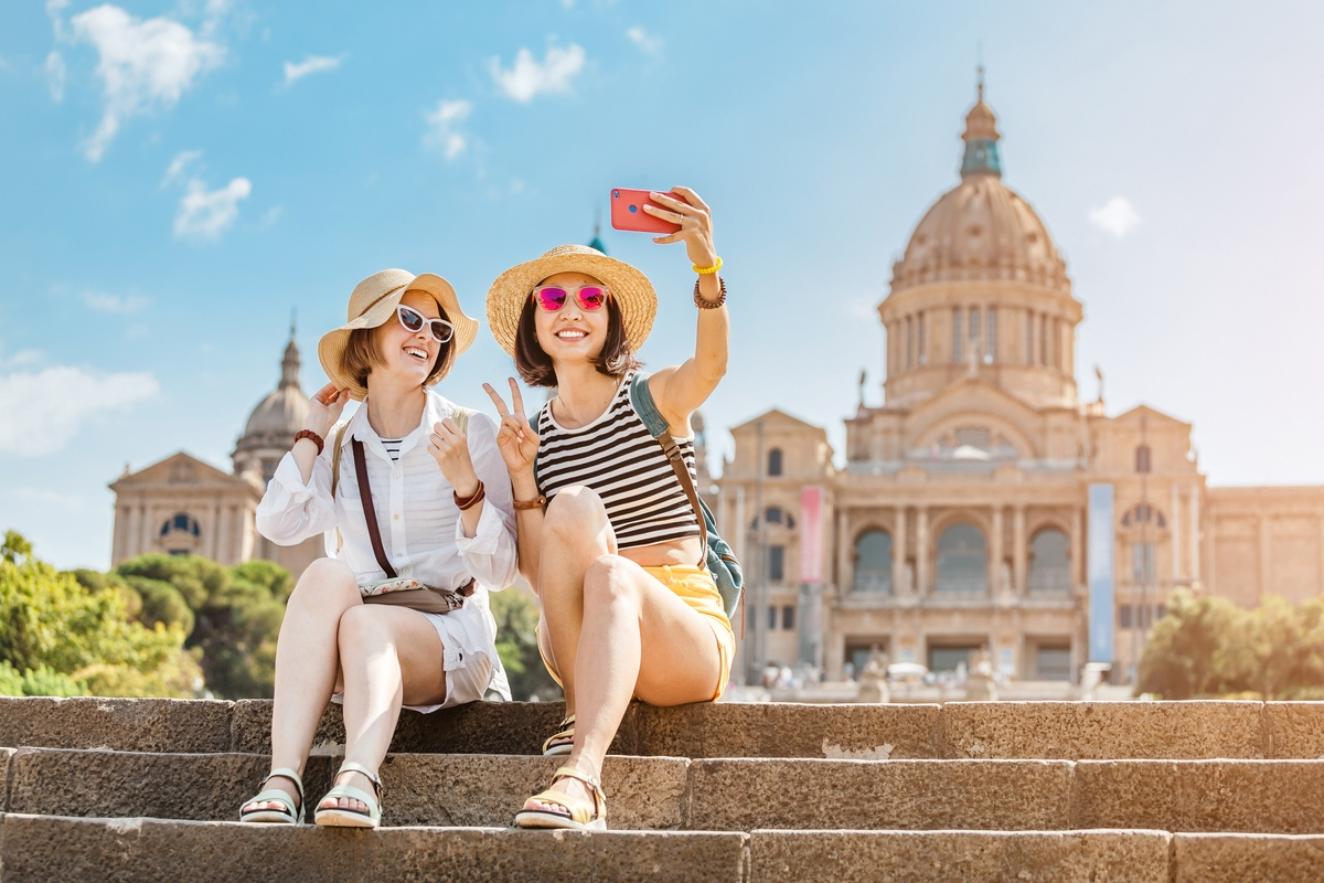 Two female tourists pose for a photo in Spain