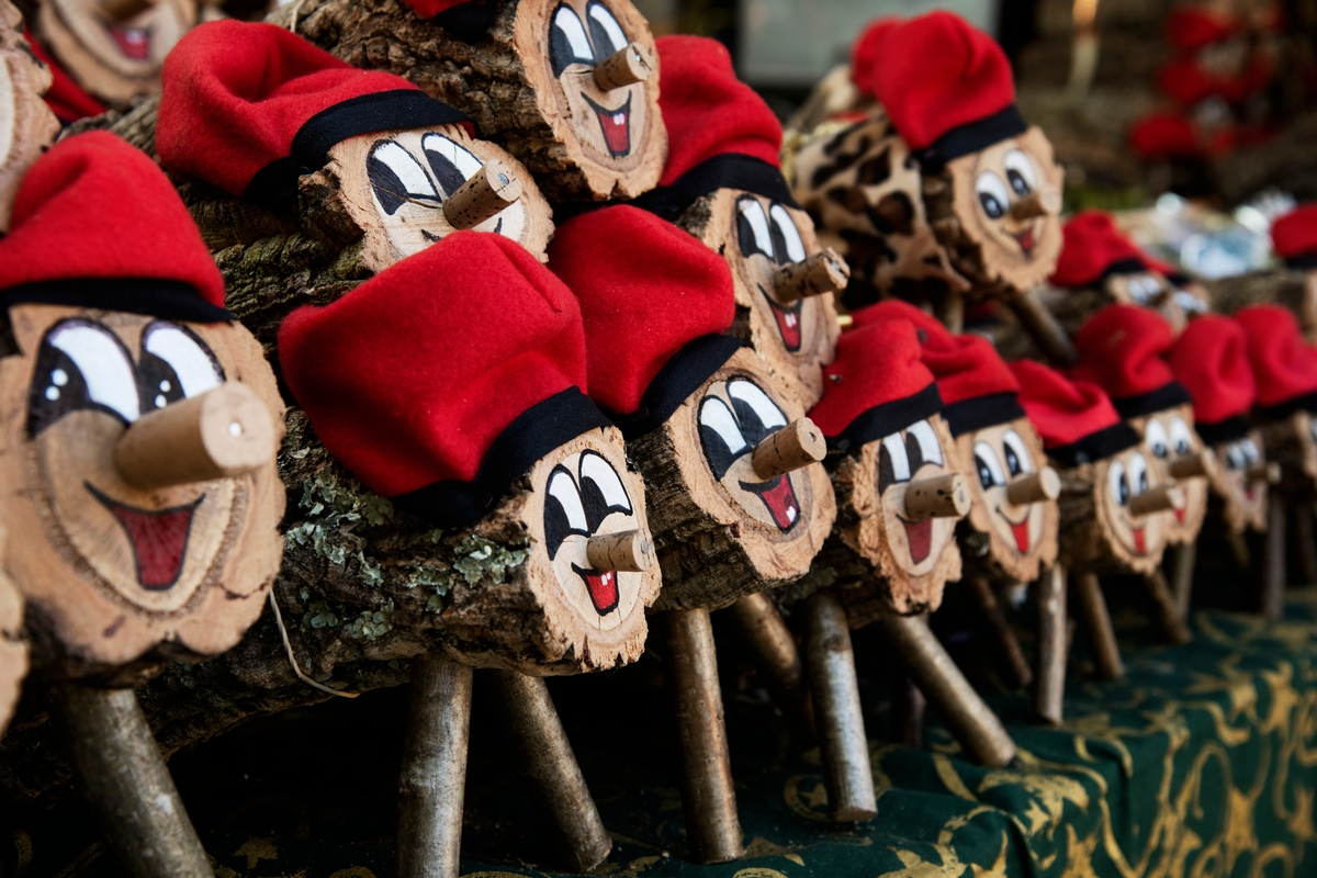 Pile of logs decorated as Tió de Nadal at Christmas in Spain